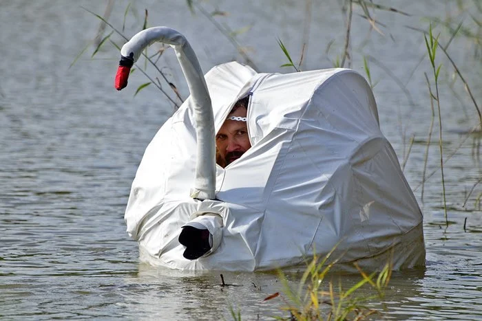 This image shows a man wearing a geese costume.